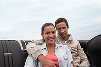 Young couple in convertible car
