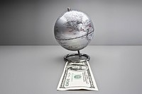 Silver globe on one hundred dollar bill