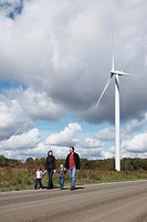 Family walking by wind turbine