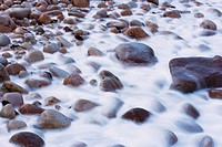 Water running over rocky beach