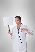 Female doctor holding a blank placard with thumbs down