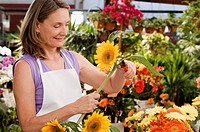 Female florist pruning flowers