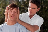 Man receiving a head massage