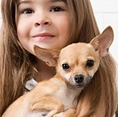 Girl carrying a dog in a veterinary hospital