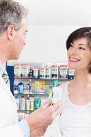Pharmacist talking with a woman