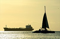 Aruba, oil tanker passing catamaran