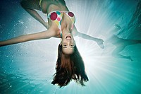 Underwater portrait of female swimmer