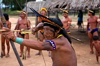 The Xingu Indian in the Aamzone, Brazil love bow and arrow competition at the village square This is entertainment for the evening hours for the india...