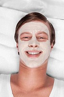 Man with face pack on his face