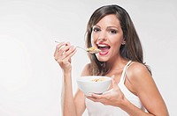 Portrait of a woman eating cereal