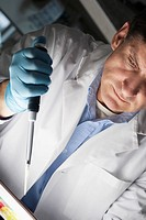 Doctor holding a pipette in a laboratory
