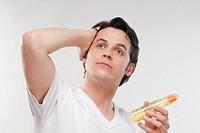 Man applying gel on his hair
