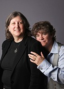 Married lesbian couple portrait looking at camera