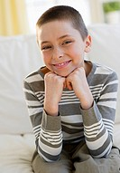 Young boy sitting on couch
