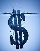 Dollar symbol sinking in water