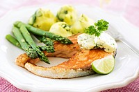 Salmon steak with herb butter and green asparagus