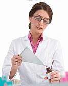 Pharmacist pouring pills into prescription bottle