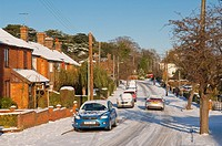 A picture showing the snow on an ungritted road in a built up area in Beccles , Suffolk , England , Britain , Uk