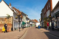 A pretty street with shoppers in Bury Saint Edmunds , Suffolk , England , Great Britain , UK
