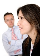 business woman with full of expectations looking away with her business partner looking at her over a white background _ focus is on the girl