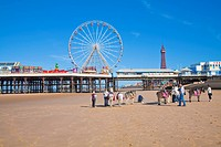 England, Lancashire, Blackpool. Donkey rides on the beach at low tide by Central Pier.