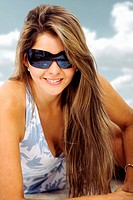 fashion girl at the beach portrait wearing sunglasses