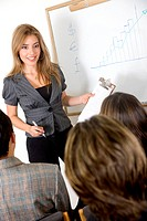 business woman doing a presentation to her colleagues in an office