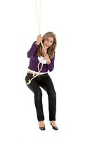 Casual woman jumping with a rope isolated over a white background