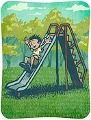 A little boy going down a slide