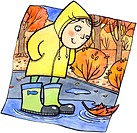 A child in rain boots looking at an orange leaf in a puddle