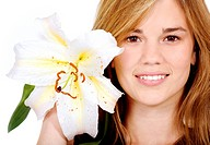 healthy girl smiling portrait holding a lily flower next to her face _ isolated over a white background