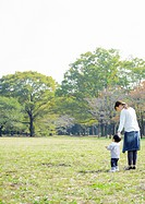 Parent and child in park