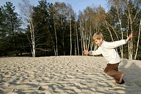 CHILD IN A SAND DUNE, FOREST OF VOUZERON, CHER 18, FRANCE