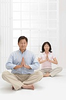 Couple, Couple making lotus position with eyes closed together