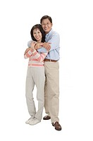 Couple, Couple standing with arms around and smiling at the camera