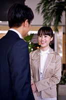 Young woman and man talking together and smiling