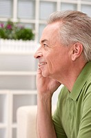 Domestic Life, a senior man looking away with smile, talking on phone