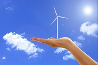 Lohas, Environmental Conservation, Digitally generated image of human hand holding a windmill in blue sky