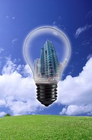 Lohas, Environmental Conservation, Digitally generated image of light blub with building in the blue sky and grass