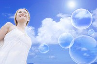 Lohas, Environmental Conservation, Digitally generated image of a young woman and bubbles in the blue sky
