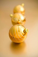 Three golden Christmas baubles
