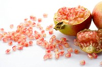 Pomegranate and scattered seeds (thumbnail)