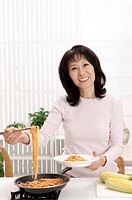 Couple, Woman holding a plate of noodles with smile