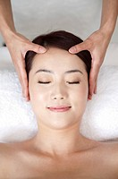 Beauty Treatment, Woman lying with eyes closed and enjoying massaging