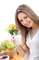 Healthy eating woman with a glass of milk isolated