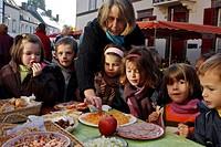 CHILDREN IN THE MARKET OF SENONCHES FOR THE WEEK OF TASTE, EURE_ET_LOIR 28, FRANCE