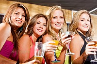 group of happy girls smiling in a bar or a nightclub