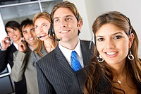 business customer service woman smiling with her team behind
