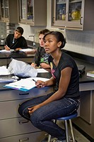 Southern California high school students listen as their teacher gives a presentation in physics class
