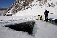 scuba diver with safety rope at an ice hole, Blindsee, Austria